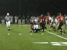 Ben Zorn (No. 57) prepares to finish what his teammate started. It would be one of the many tackles that made Zorn a standout athlete during his time at George Mason High School. (Photo: Bob Morrison, Bonnie Briar Productions, LLC)